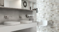 Modern bathroom interior with wash basin against concrete wall